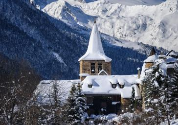 snowy town and mountain in the Aran Valley