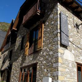 stone walls and wooden windows Hotel Pèira Blanca Aran Valley